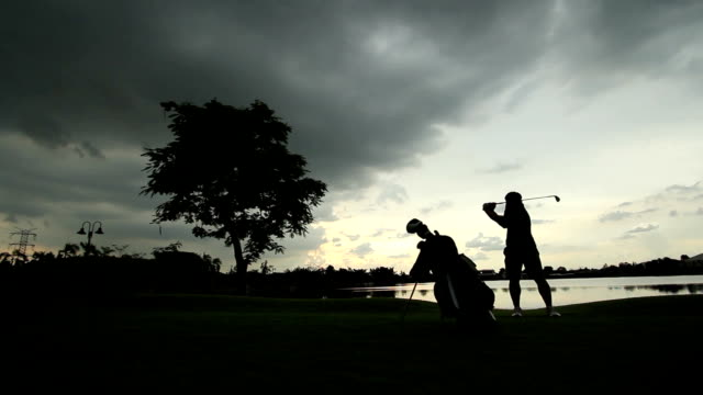 golfer at sunset - golf swing stock videos & royalty-free footage