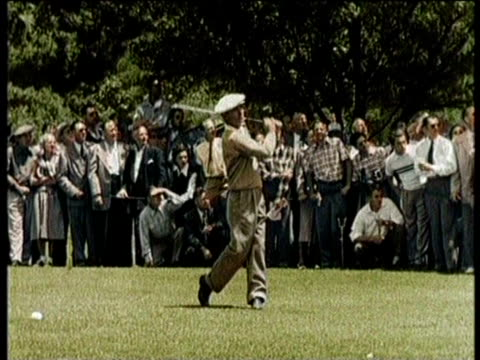 golfer ben hogan sinks a put and accepts a trophy / ben hogan sinks another put and is swarmed by celebrating spectators / huge crowds watch ben... - narrating stock videos & royalty-free footage