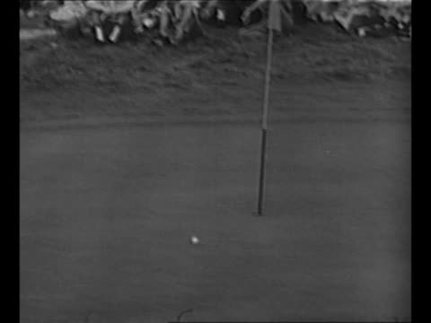 golfer ben hogan tees off camera follows ball as it drops on putting green very near the cup / hogan sinks putt to win the 1953 us open / hogan's... - 1953 stock videos & royalty-free footage