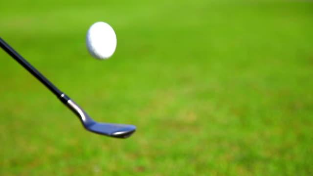golfer bouncing golf ball on club - golf ball stock videos & royalty-free footage