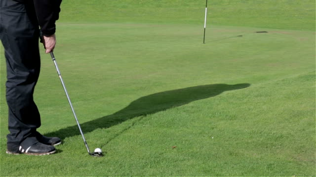 golfer chipping from edge of green - golf swing stock videos & royalty-free footage