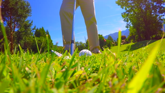 golfer chipping the golf ball - golf shoe stock videos and b-roll footage