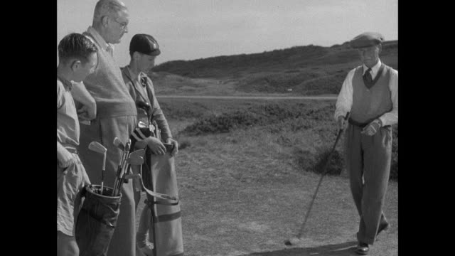 ms golfer driving ball into bunker / guernsey, british crown isles - golf stock-videos und b-roll-filmmaterial