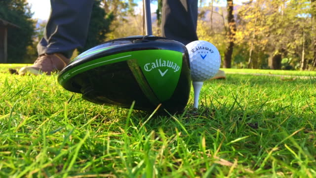 golfer hitting callaway golf ball from the tee with a callaway epic driver golf club in a sunny day in switzerland - golf club stock videos & royalty-free footage