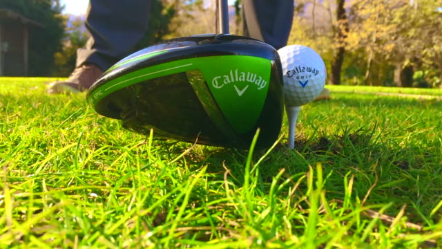 "golfer hitting callaway golf ball from the tee with a callaway ""epic"" driver golf club in a sunny day in switzerland. - golf club stock videos & royalty-free footage"