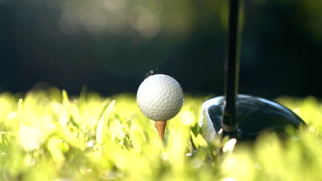 golfer hitting golf ball - slow motion