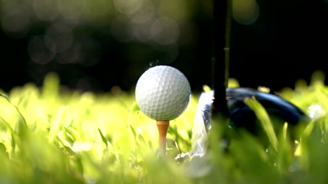 golfer hitting golf ball - slow motion - golf ball stock videos and b-roll footage