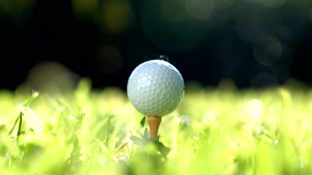 golfer hitting golf ball - slow motion - golf swing stock videos & royalty-free footage