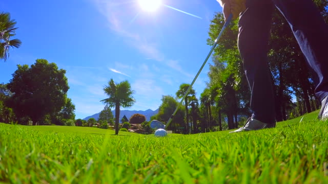 golfer hitting the golf ball in the front of the camera - golfer stock videos and b-roll footage