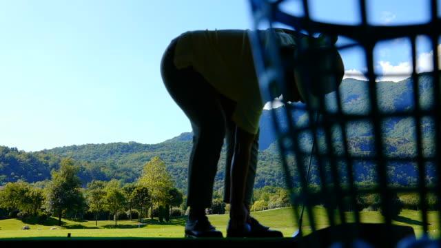 golfer hitting the golf ball on driving range - driving range stock videos & royalty-free footage