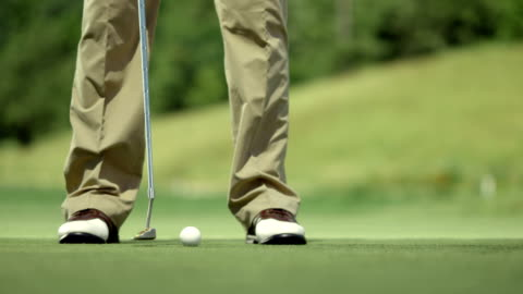 ms la golfer holing the ball - green golf course stock videos & royalty-free footage