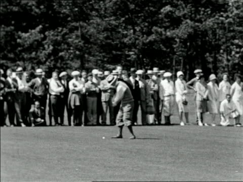 b/w 1927 golfer in hat teeing off as crowd watches in background / national amateur championship golf - 1927 stock videos & royalty-free footage