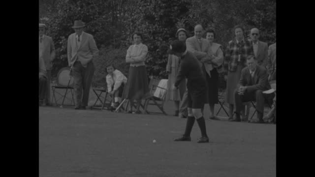golfer jackie pung tees off / woman in slacks tees off / woman in shorts tees off / another woman in shorts tees off / pung tees off / louise suggs... - shorts stock-videos und b-roll-filmmaterial