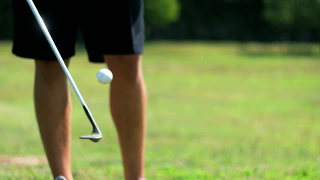 golfer juggling with golf ball and golf club - stunt stock videos & royalty-free footage