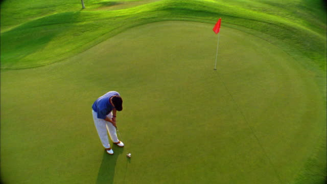 a golfer just misses a putt on a green. - driver golf club stock videos & royalty-free footage