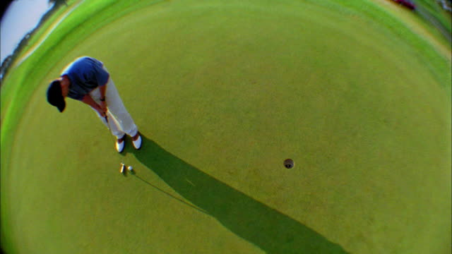 vídeos y material grabado en eventos de stock de a golfer just misses a putt on a green. - putt