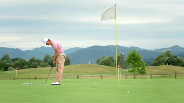 hd dolly: golfer lining up a putt - golf swing stock videos & royalty-free footage