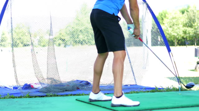 golfer missing a ball while practicing - golfer stock videos & royalty-free footage