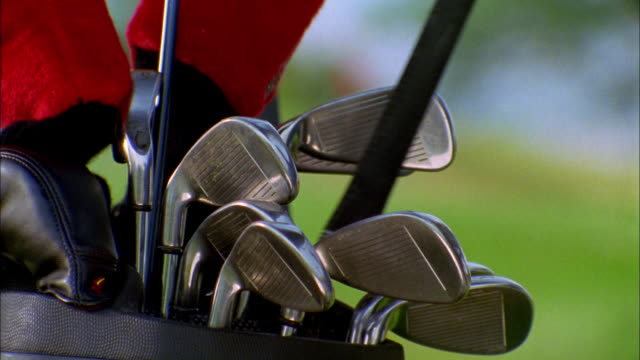 a golfer places a club in his bag. - golf club stock videos & royalty-free footage