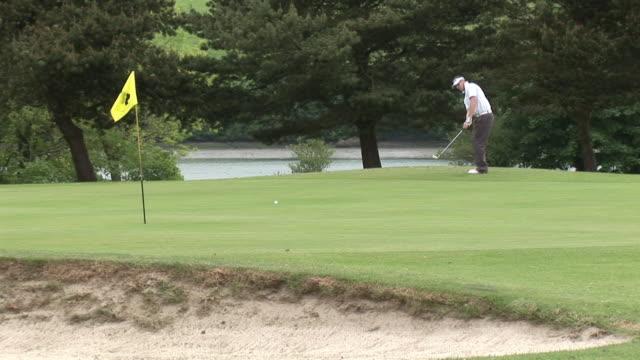 ms, golfer playing golf in bunker, kinsale, ireland - sun visor stock videos & royalty-free footage