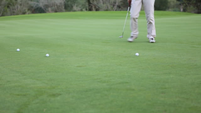 Golfer practising