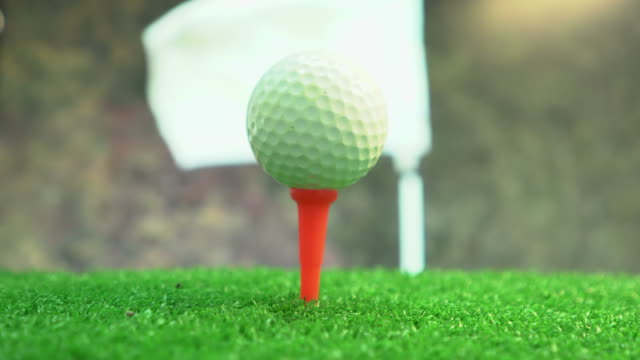 golfer putting a ball on a tee - teeing off stock videos & royalty-free footage