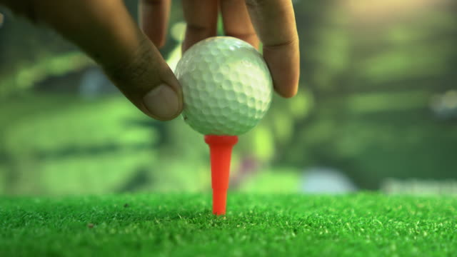 golfer putting a ball on a tee - golf club stock videos & royalty-free footage