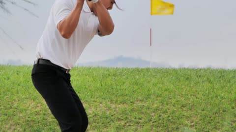 golfer putting golf ball on the green golf,sports cinemagraphs - golf swing stock videos & royalty-free footage