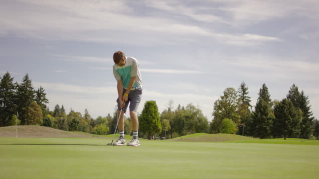 golfer putting on a putting green - golf shoe stock videos & royalty-free footage