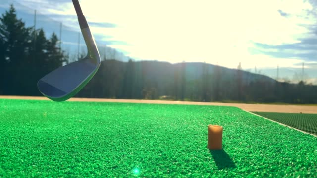 golfer putting the golf ball on the tee on driving range - driving range stock videos & royalty-free footage