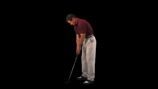 golfer putting - this clip has an embedded alpha-channel - putting stock videos & royalty-free footage