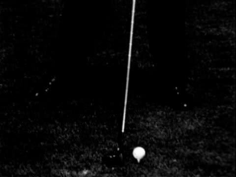 golfer sam sneed practicing his swing at a driving range. golf - slammin' sam sneed on january 01, 1953 - driving range stock videos & royalty-free footage