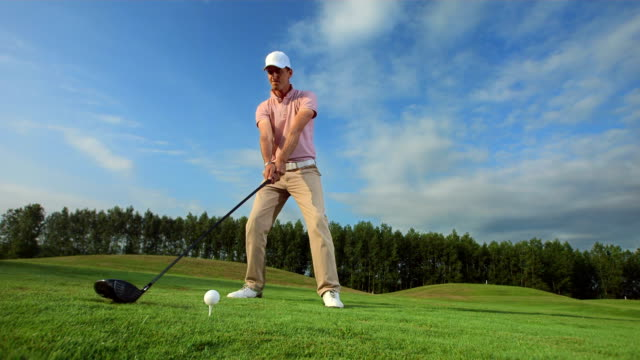 hd slow motion: golfer taking a crushing tee shot - drive ball sports stock videos & royalty-free footage