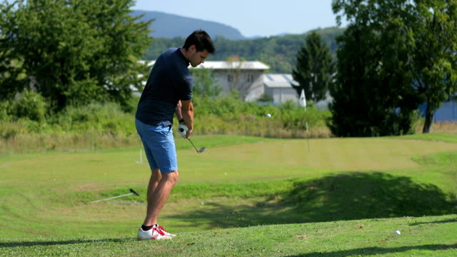 golfer taking a swing - competition round stock videos and b-roll footage