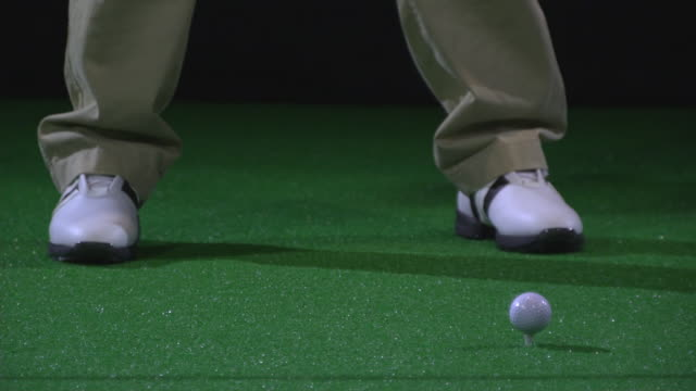cu slo mo golfer teeing off / berlin, germany - golf shoe stock videos & royalty-free footage