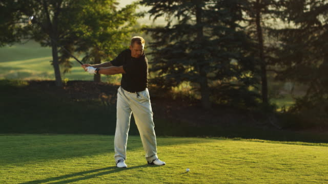 golfer teeing off - golf swing on white stock videos & royalty-free footage