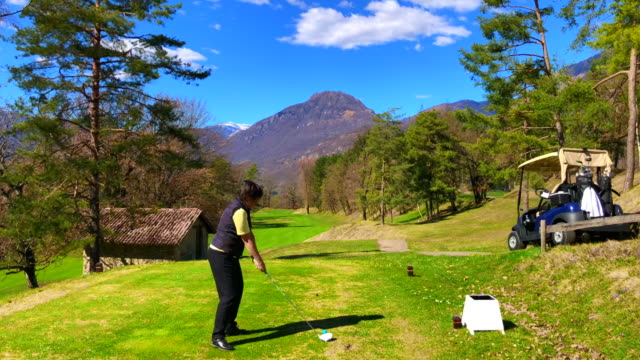 golfer teeing off with driver - teeing off stock videos & royalty-free footage