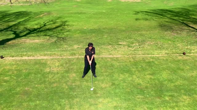 golfer teeing off with golf club driver - teeing off stock videos & royalty-free footage