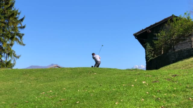 golfer teeing off with golf club driver - golf shot stock videos & royalty-free footage