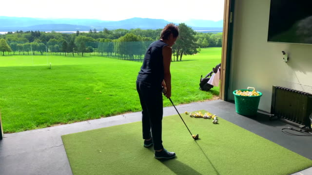 golfer training on driving range - driving range stock videos & royalty-free footage