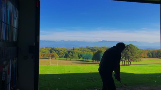 golfer training on golf swing - golf swing silhouette stock videos & royalty-free footage