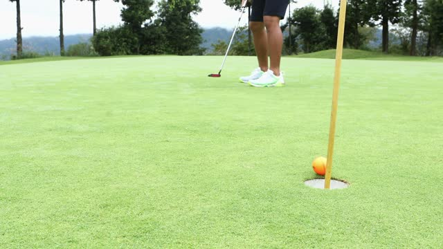 a golfer who makes a great putt on the green - taking a shot sport stock videos & royalty-free footage