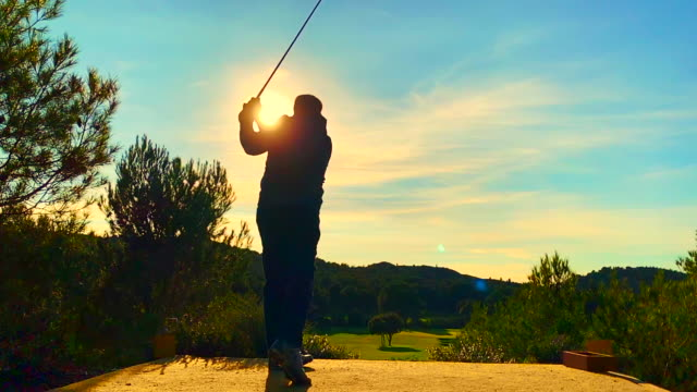 golfer with golf swing against sun - golf swing silhouette stock videos & royalty-free footage