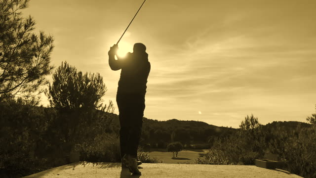 golfer with golf swing against sun - golf swing on white stock videos & royalty-free footage