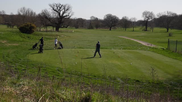 golfers at the glendale golf richmond park golf course as lockdown rules ease allowing for outdoor and group sports as the uk starts to emerge from... - emergence stock videos & royalty-free footage