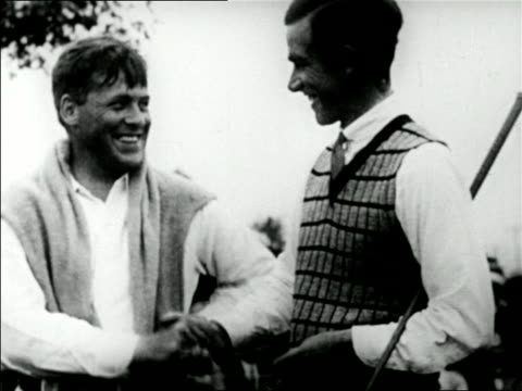 b/w 1928 golfers bobby jones and johnny farrell shaking hands / mateson il / us open / newsreel - 1928 stock videos & royalty-free footage