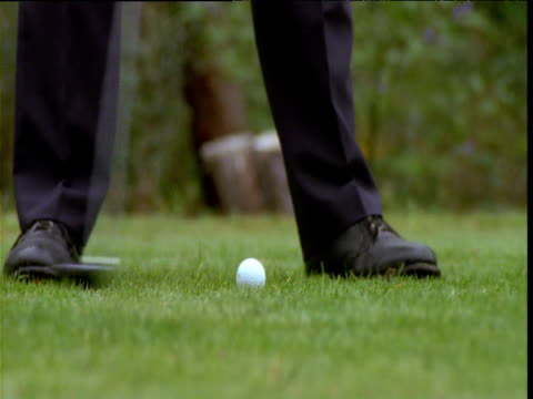 golfer's feet as he takes stroke at golf ball and retrieves tee, victoria, australia - golf swing stock videos & royalty-free footage