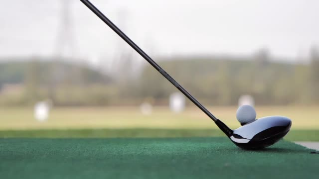 golfers hit sweeping and keep golf course in the summer for relax time.golfer putting golf ball on the green golf.sports cinemagraphs - golf club stock videos & royalty-free footage