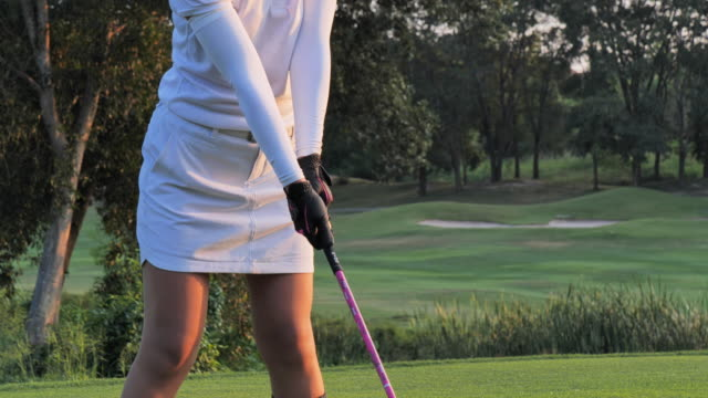 golfers hit sweeping in the summer for relax time, sport concept. - hitting stock videos & royalty-free footage