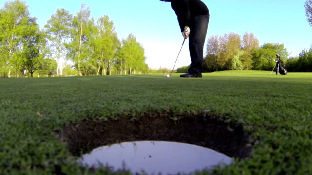 Golfers Putt From A Worms Eyed Perspective